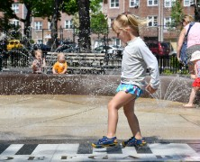 Newly renovated Astoria playground gets a piano-shaped spray shower for kids