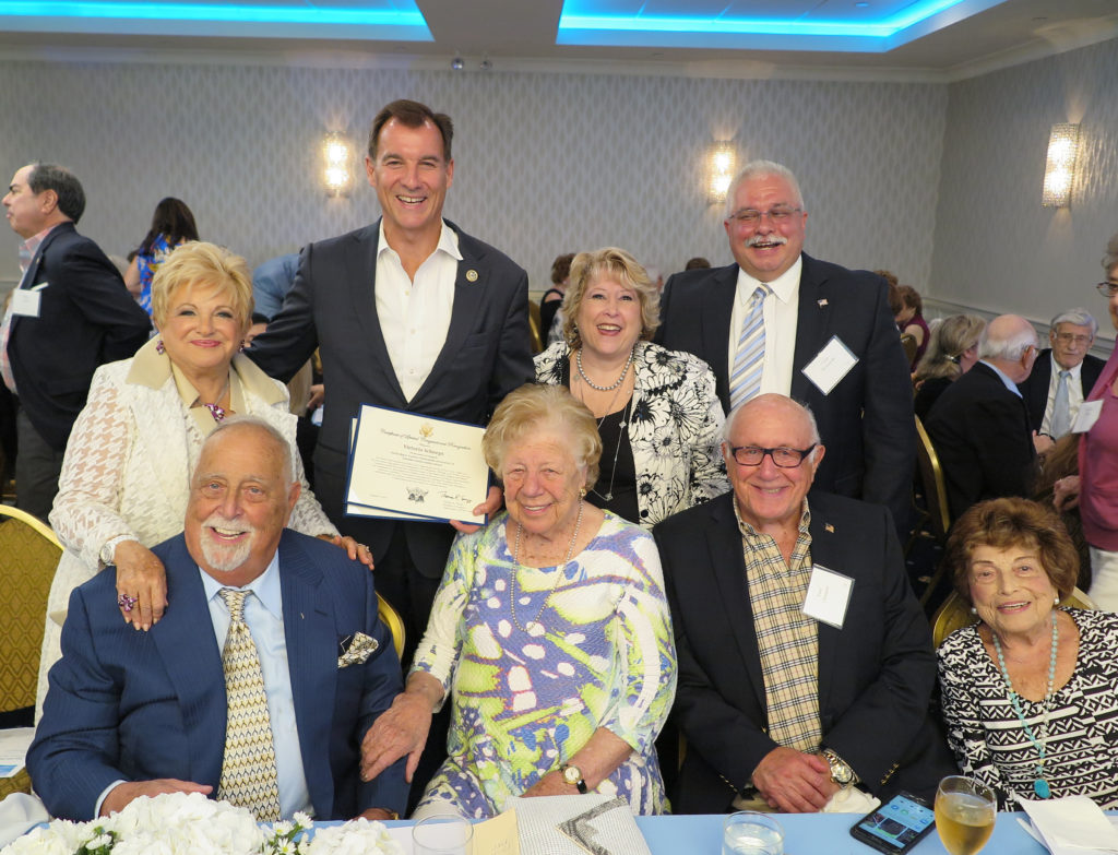 At the UJA event were (standing, left to right): Publisher Vicki Schneps, Congressman Tom Suozzi, Debra Markell-Kleinert, NST General Manager Glen Kotowski and (seated, left to right): Marty Miller, former Borough President Claire Shulman, Fred Chernow and Rita Pasternak